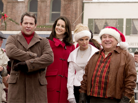 The Finches (Matthew Broderick and Kristin Davis) and Halls (Kristin Chenoweth and Danny DeVito) display varying reactions to a holiday-themed event.